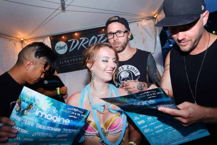 The Glitch Mob signs autographs during our artist meet and greet at Imagine Music Festival in Atlanta, Georgia.