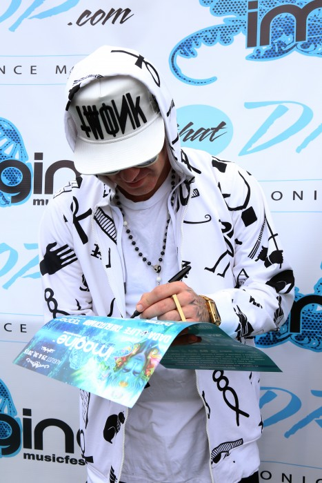 Brillz signs an autograph during our artist meet and greet at Imagine Music Festival in Atlanta, Georgia.