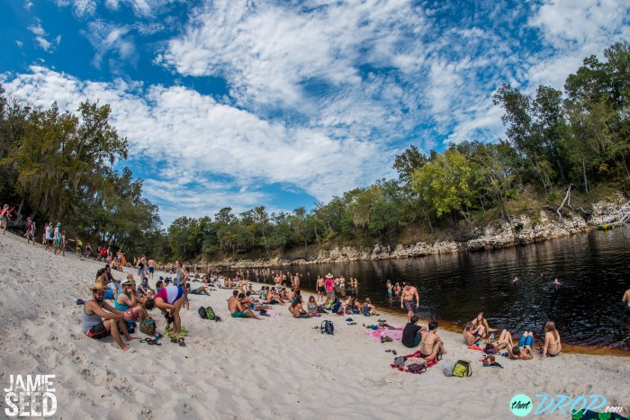 Relaxing by the river during the day. Photo by Jamie Seed Photography